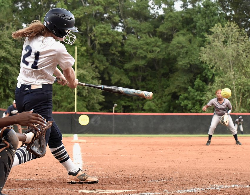 Woodland senior Kailey Baker lines a hit against Marietta during Friday's game at Twins Creek Park in Woodstock. Baker finished 3-for-4 with an RBI in a 16-0, three-inning win.