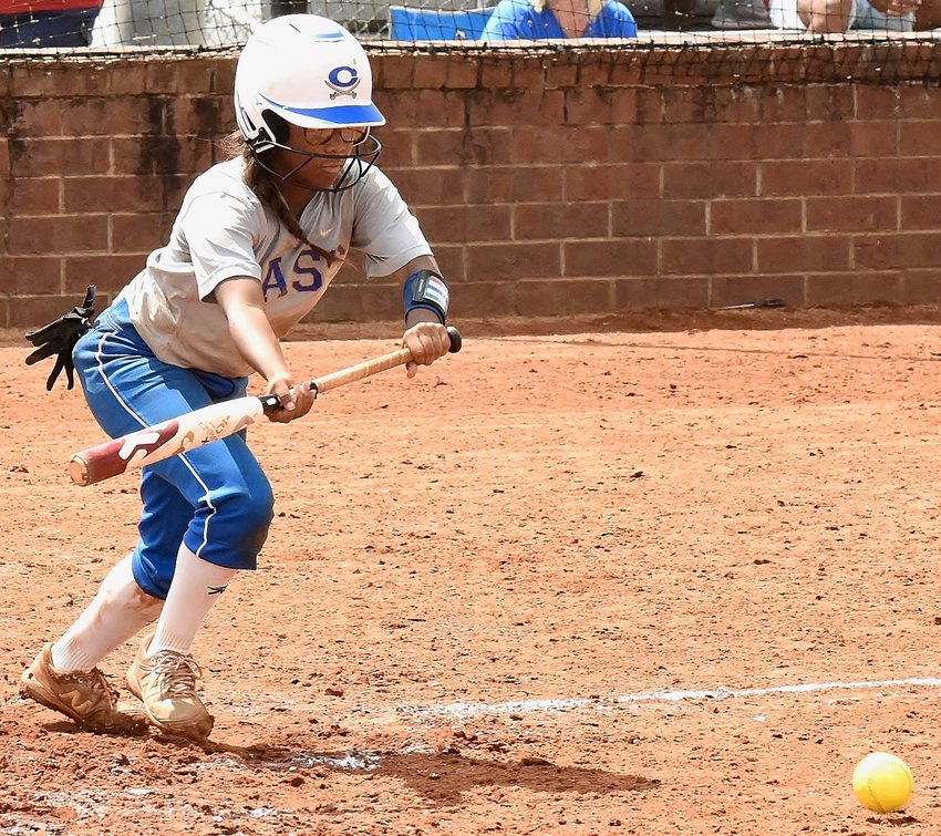 Cass junior Eryn Lee bunts against Blessed Trinity during the fourth inning of Saturday's home game. Lee reached safely on the play, and teammate Alexis Woods scored from third base. Overall, Lee went 2-for-3 with a walk, an RBI and two runs scored.