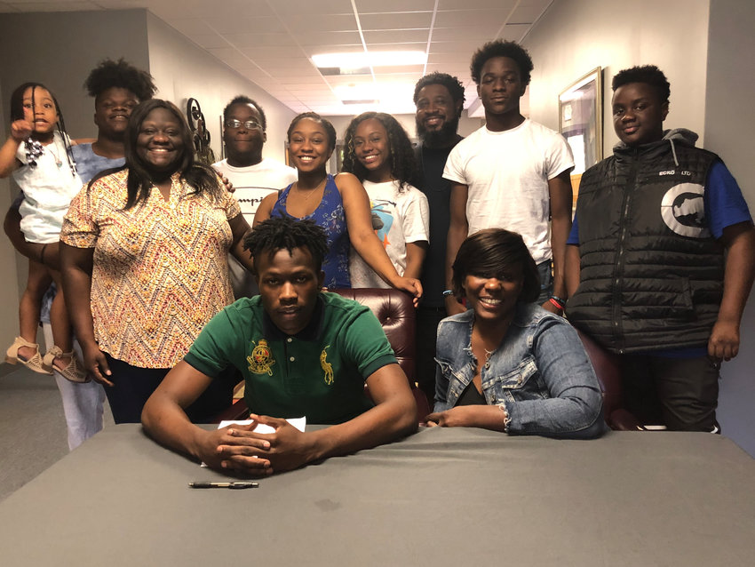 Excel Christian graduate Rayshawn Womack recently signed to play basketball at Francis Marion in Florence, South Carolina. On hand for the signing were, from left, Harmoni Womack, niece; Ericson Mosley, cousin; Maydia Mosley, aunt; Tyler Womack, brother; Kaliah Womack, sister; Shania Loveless, sister; Nate Loveless, stepfather; Lita Loveless, mother; Josiah Mosley, cousin; and Tyre Loveless, brother.