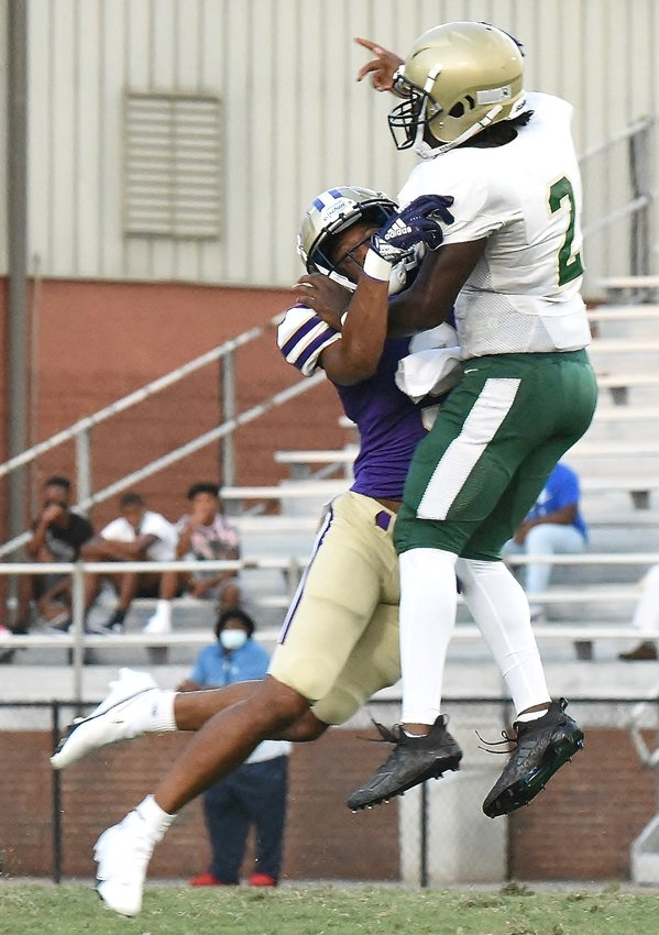 Cartersville senior outside linebacker Amarai Orr hits Morrow quarterback Burt Hunter as Hunter releases a pass Friday night during the Canes' 42-0 win at Weinman Stadium in the season opener.