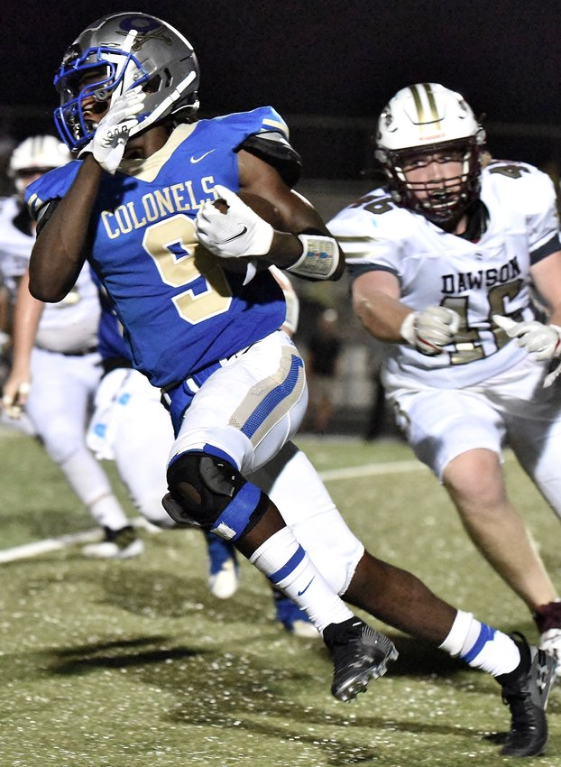 Tanayce Calhoun carries the ball during Friday's game at Doug Cochran Stadium against Dawson County. The Colonels welcome intracounty rival Adairsville to The Doug on Friday.