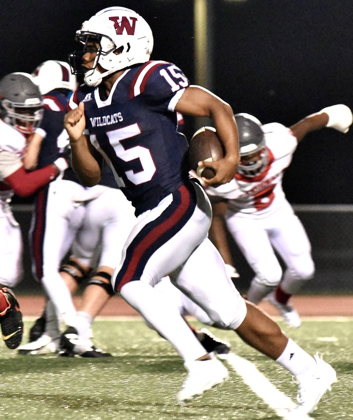 Woodland senior Johnathan Thomas runs for an 82-yard touchdown during Friday's win over Osborne at Wildcats Stadium. Thomas was 4-for-7 for 156 yards passing with one touchdown, and he also ran for 159 yards and two touchdowns on three attempts.