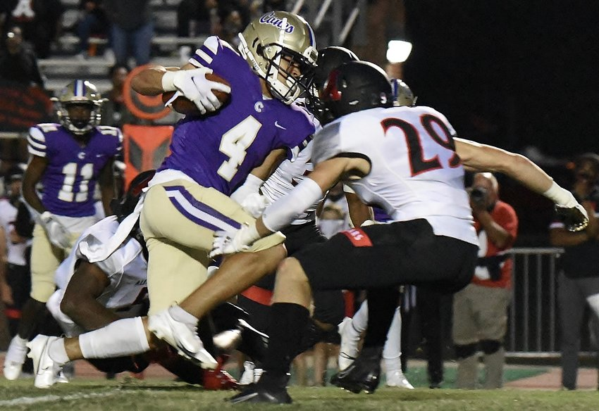 Cartersville senior Sam Phillips looks to split Alexander defenders during Friday's game at Weinman Stadium. Phillips had seven receptions for 63 yards and also intercepted a pass in a 35-3 win.