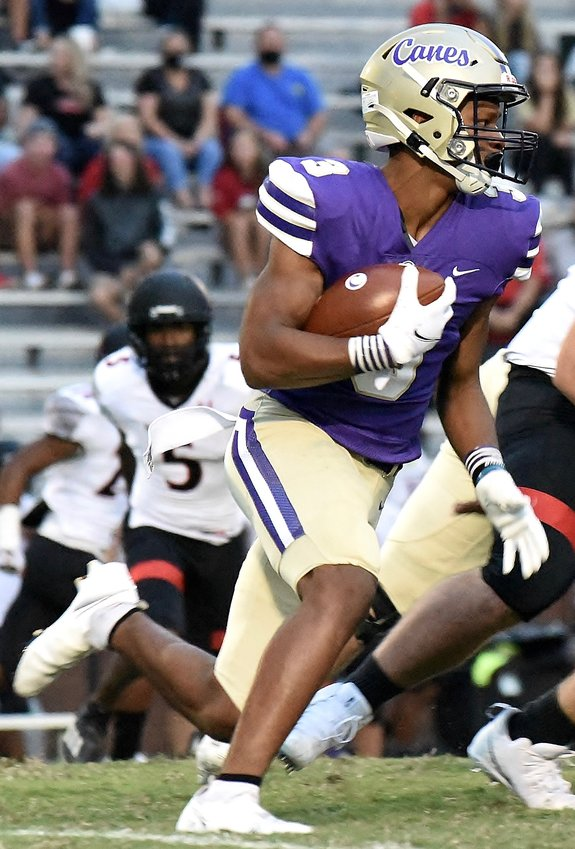 Cartersville senior Evan Slocum carries the ball on the opening play from scrimmage against Alexander Friday at Weinman Stadium. Cartersville and Cass are currently 3-0, and the two teams could both be undefeated when they meet in Week 7 to begin Region 7-AAAAA play.