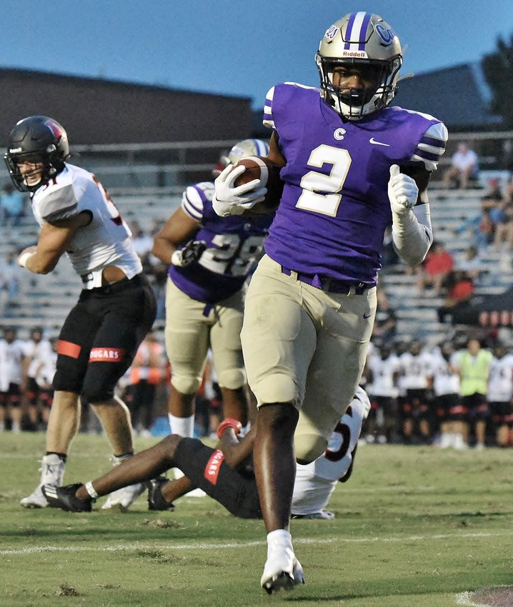 Cartersville senior Quante Jennings crosses the goal line for his second and his team's second touchdown of the night against Alexander Friday at Weinman Stadium. Jennings finished with 107 yards and four touchdowns on the ground in a 35-3 victory.
