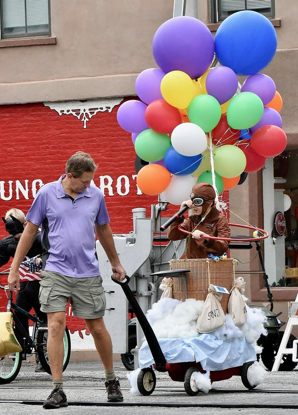 Mark Matthews pulls his son Knox down Main St. in the 65th Kiwanis of Cartersville Kiddie Day Parade Saturday. More than 40 children participated in the annual event.