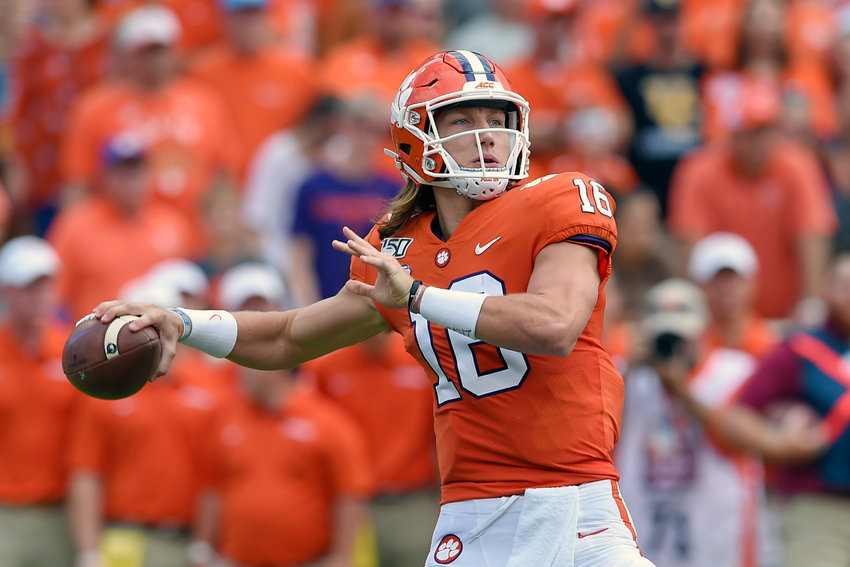 In this Oct. 12, 2019, file photo, Clemson's Trevor Lawrence throws a pass during the first half of a game against Florida State in Clemson, South Carolina.
