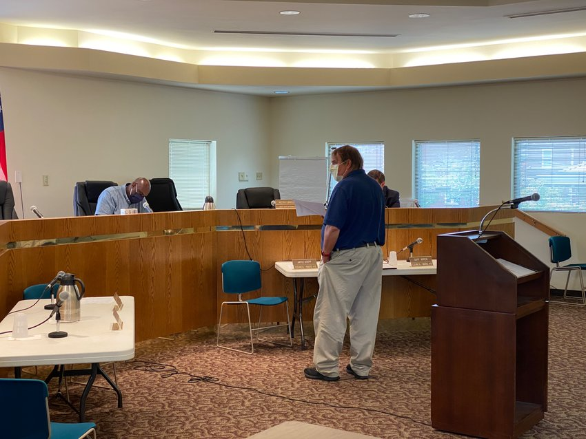 Cartersville Assistant City Attorney Keith Lovell, standing, presides over Friday afternoon's ethics committee meeting.