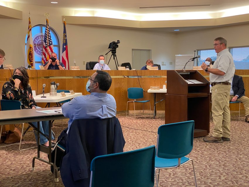 Cartersville Water Department Director Bob Jones takes to the podium at last week's city council meeting.