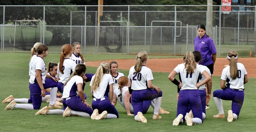 Cartersville head coach Shannon Suarez talks to her team after a 10-5 loss to Blessed Trinity in the opener of a Region 7-AAAAA doubleheader Tuesday at home. The Canes dropped Game 2 by an 11-7 final score. The results clinched Blessed Trinity a spot in the Class 5A state playoffs, while simultaneously eliminating Cartersville from postseason contention.
