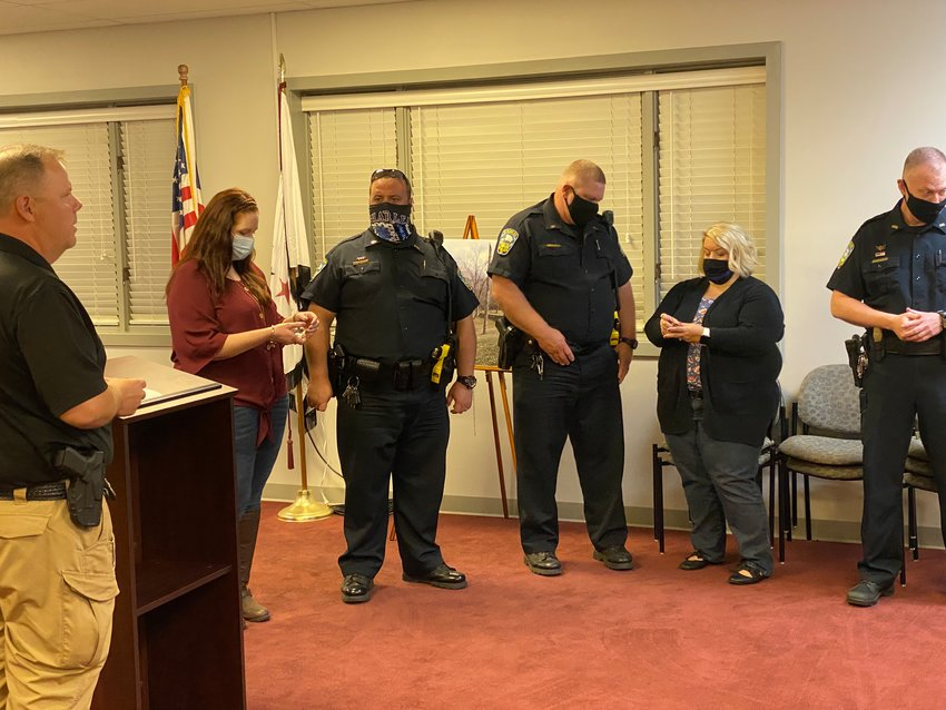 A police department promotion ceremony capped off Tuesday evening's Euharlee City Council meeting.