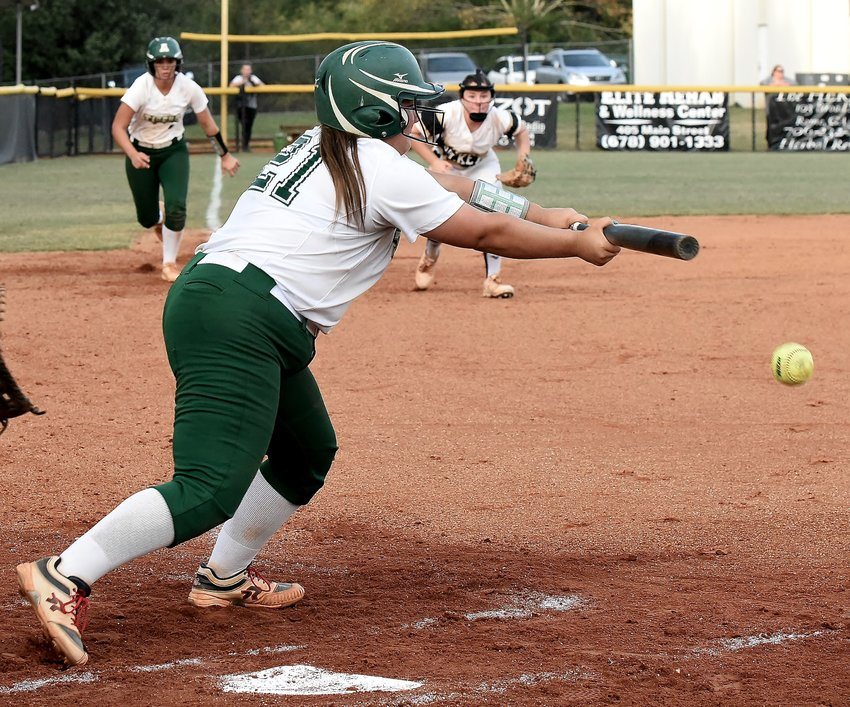 Adairsville senior Chloe Souders lays down a bunt to score teammate Sadye Johnson from third base against Rockmart during a Region 6-AAA playoff doubleheader Thursday on the road.