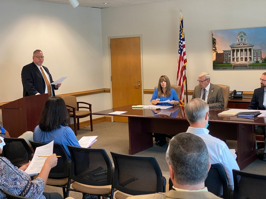 Bartow County Administrator Peter Olson takes to the podium at Wednesday morning's public meeting.