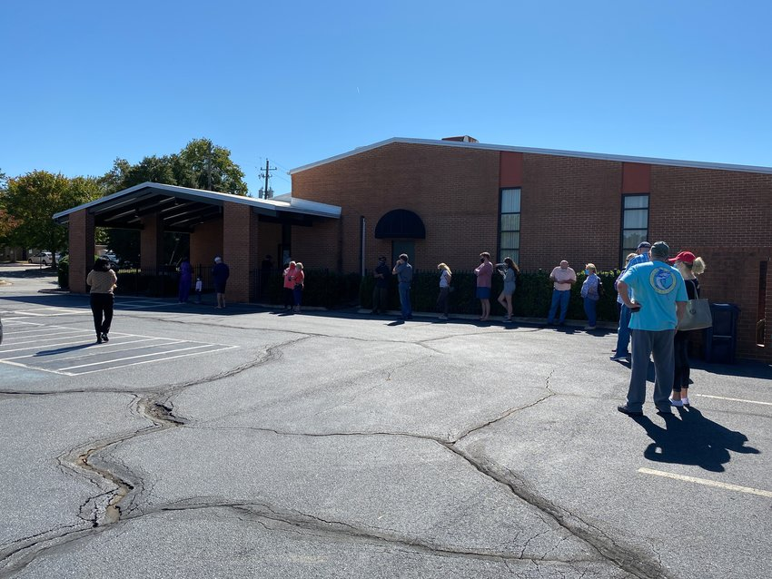 A long line of voters curls outside the Cartersville Civic Center on Tuesday afternoon.