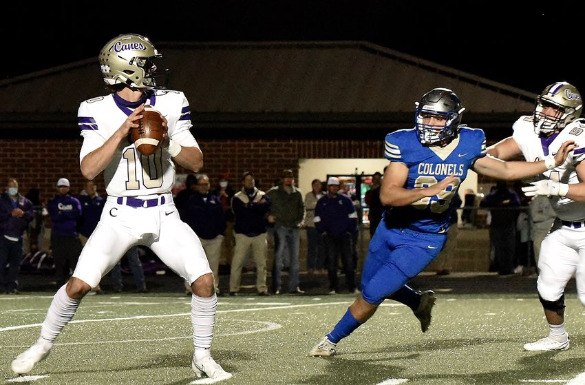 Cartersville senior Stratton Tripp drops back to pass on the first play of the game against Cass Friday at Doug Cochran Stadium. The play resulted in an 80-yard touchdown pass from Tripp to Devonte Ross, who scored three touchdowns in a 59-0 win.