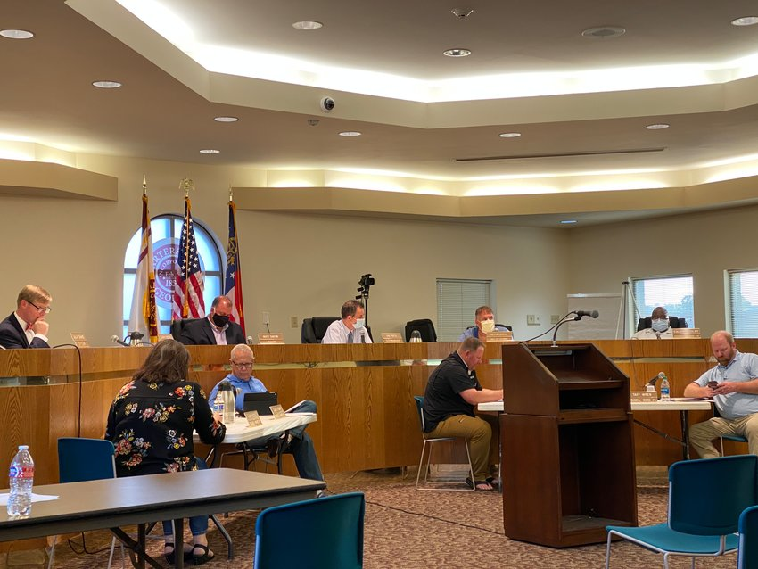 Members of the Cartersville City Council gather for last week's public meeting.