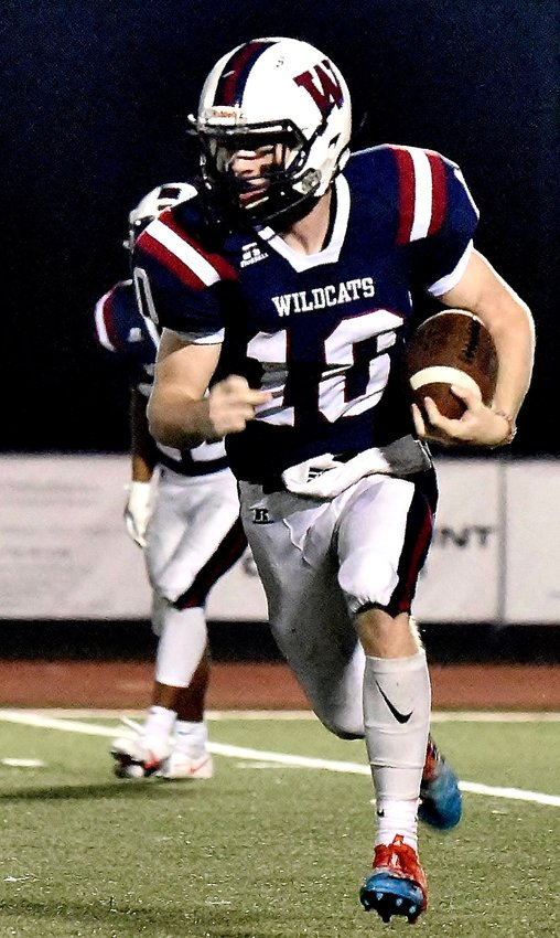 Woodland sophomore quarterback Chase Carson carries the ball against Cass during a Region 7-AAAAA game Oct. 23 at Wildcat Stadium.