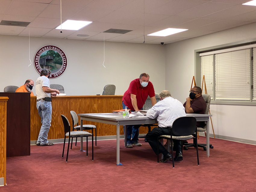 Members of the Euharlee Planning and Zoning Commission convene for Tuesday evening's public meeting.