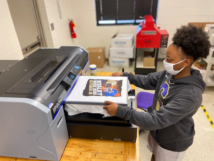 Cartersville High senior Adariah Dyer works on creating a T-shirt for the school's Rivalry Week last month.