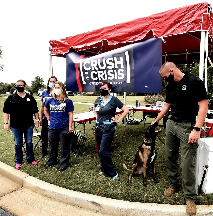 The Cartersville Medical Center opioid take back team, along with representatives from the Bartow County Sheriff's Office, take part in the Crush the Crisis event Oct. 24 at The Hope Center.