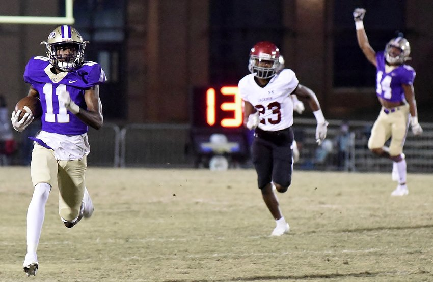 Cartersville senior Devonte Ross returns a punt for a touchdown during the first half against Jackson Friday in the first round of the state playoffs at Weinman Stadium.