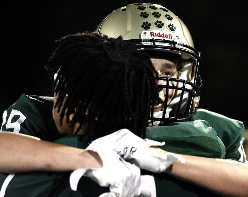 A pair of Adairsville football players hug after a 45-31 loss to Dawson County in the first round of the Class 3A state playoffs.
