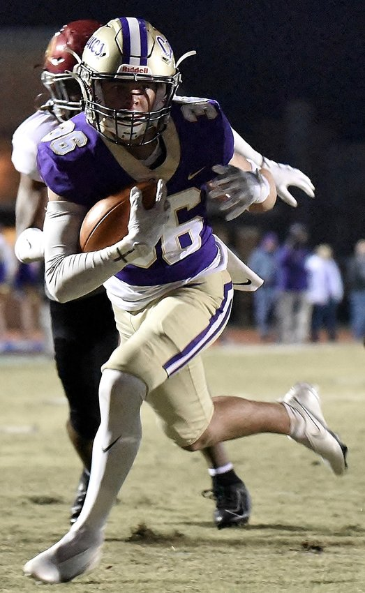 Cartersville sophomore Collin Fletcher scores a touchdown against Jackson (Atlanta) during a Class 5A first-round state playoff game Friday at Weinman Stadium. The Canes defeated the Jaguars 56-6 to win their ninth straight playoff opener.