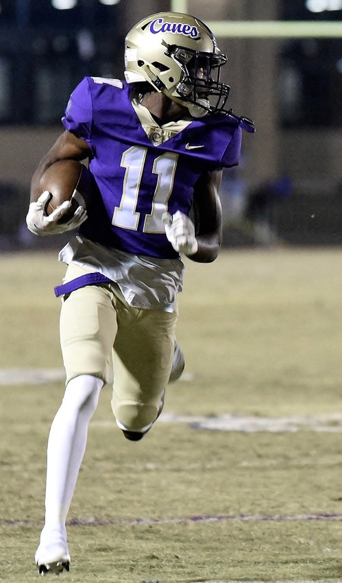 Cartersville senior Devonte Ross heads for the end zone on a punt return touchdown against Jackson (Atlanta) during Friday's game at Weinman Stadium. Ross had two catches for 72 yards and two touchdowns, in addition to the special-teams score.