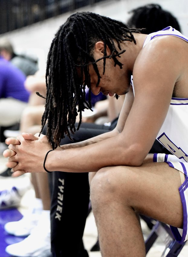 Cartersville senior Kolbe Benham sits on the bench against Calhoun during a Region 7-AAAAA game Friday at home.