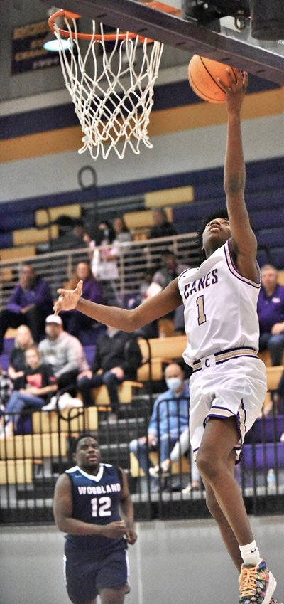 Cartersville junior Kam Callahan converts a layup against Woodland during a Region 7-AAAAA game Friday at The Storm Center.