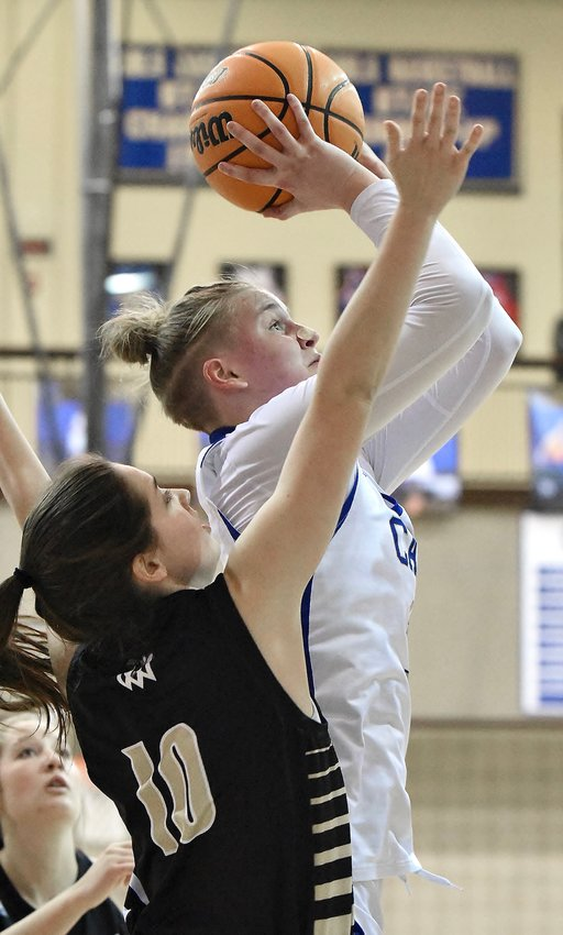 Cass junior Claire Davis goes up for a shot attempt against Calhoun during a Region 7-AAAAA game Friday at home. Davis recorded 13 points, seven rebounds and six steals in a 61-43 victory.