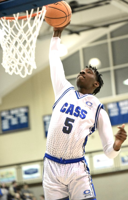 Cass junior Zaylan Chaney throws down a dunk against Calhoun during a Region 7-AAAAA game Friday at home. Chaney racked up 17 points in a 74-59 victory.