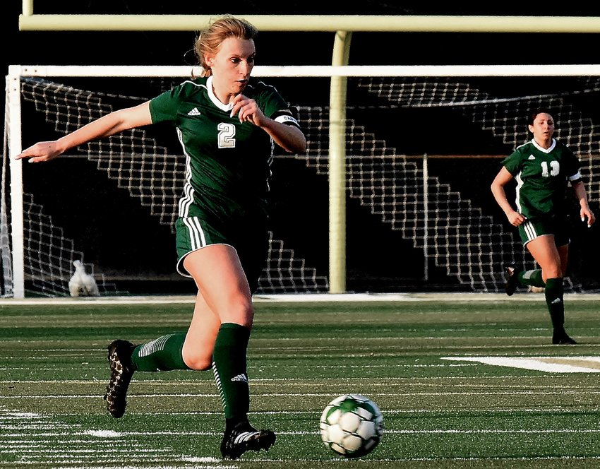 Adairsville senior Cat Wheeler heads up the field against Calhoun during a non-region game Tuesday at Tiger Stadium. Wheeler scored both of her team's goals in a 4-2 defeat.