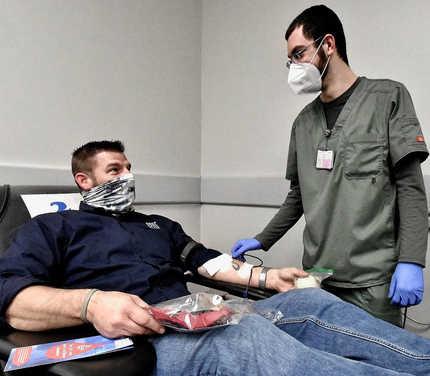 Blood Assurance Donor Care Specialist Hunter Calvert, right, talks with donor Brian Holloman of Calhoun at the Cartersville Blood Assurance donation center Wednesday.