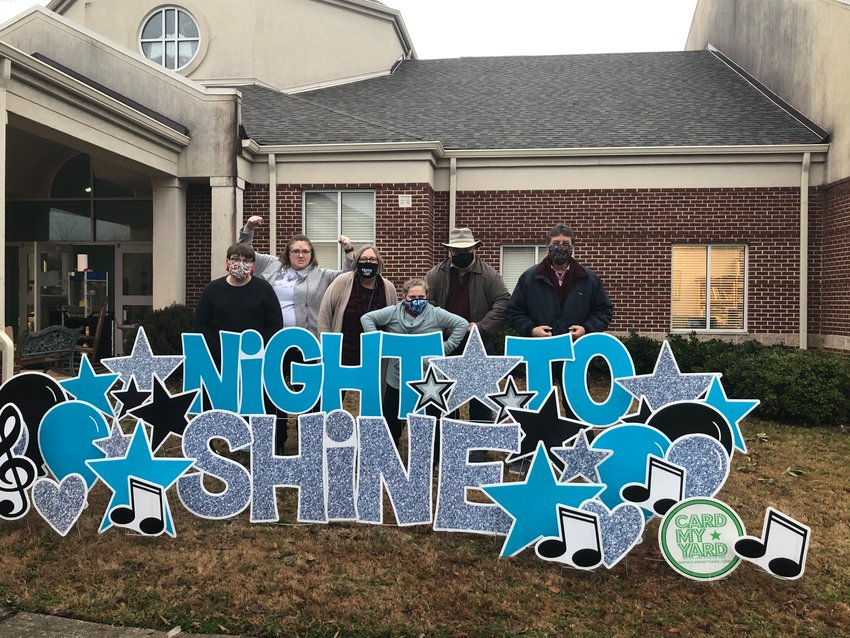 Volunteers, from left, Landon Gravely, Cindi Gravely, Josie Hickom, Kendall Gravely, Doug Hickom and the Rev. Charlie Marus at Faith United Methodist Church in Cartersville were on hand to greet their Night to Shine guests who came by to pick up their gift bags before the big event Feb. 12.