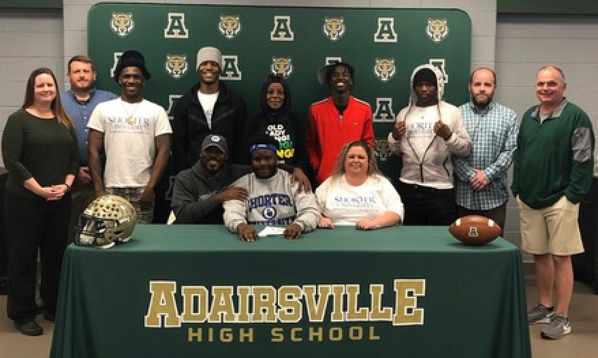 Adairsville High senior Tywun Gordon signed to play football at Shorter in Rome. On hand for the signing were, from left, front row: Antwun Gordon Sr., father; Nikki Jones; back row, Meredith Barnhill, AHS athletic director; Robby Stone, AHS defensive line coach; Keyonce Pitts; Tokyo Gordon; Lavern Gordon, grandmother; Khyree Henderson; Brittany Porter; John Terrell, AHS defensive line coach; and Eric Bishop AHS head coach.