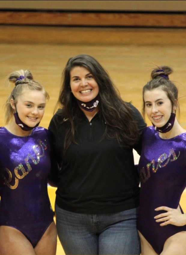 Cartersville girls gymnastics coach Kimberly Mosteller poses with freshman Karley Garrison, left, and sophomore Annaston Wilson during a meet March 17 at Westminster. The team competed in its second meet of the season Wednesday at Pace Academy.