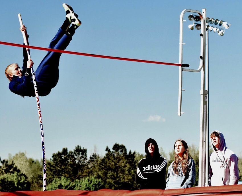 Woodland senior Emmie Berry clears the bar — set at 9 feet, 1 inch — to win the girls pole vault event during the Bartow County Championships Thursday at home.