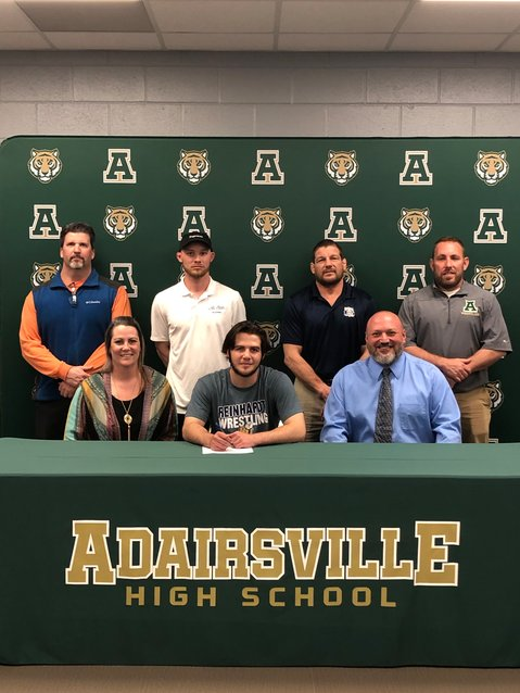 Adairsville's Dalton Cornett, front, center, recently signed to wrestle at Reinhardt University. Pictured are, from left, front row, Tina Williams, mother; Aaron Cornett, father; back row, Tony Sellers, AHS wrestling coach; Justin Martin, middle school coach; Eric Ruggles, club coach; and Ryan Torrence, AHS head wrestling coach.