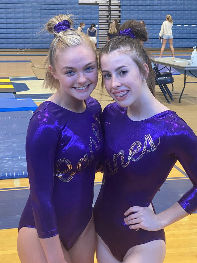 Cartersville freshman Karley Garrison, left, and sophomore Annaston WIlson competed in the Canes' third meet of the season Tuesday at The Lovett School.