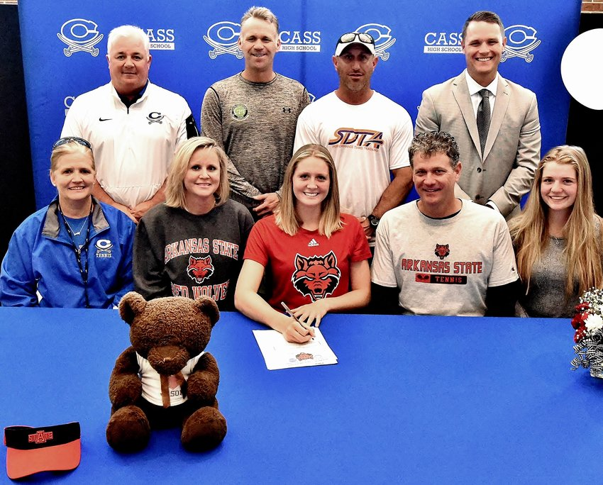 Cass High senior Emily Surcey signed to play tennis at Arkansas State in Jonesboro. On hand for the signing were, from left, front row: Sydney Hughes, CHS head coach; Andrea Surcey, mother; Mike Surcey, father; Christina Surcey, sister; back row, Nicky Moore, CHS athletic director; Jason Parker and Jason Patti, personal tennis coaches; and Steve Revard, CHS principal.