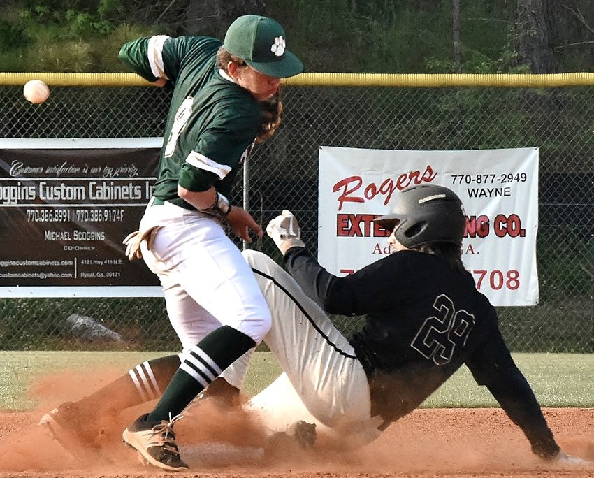 A throw down to second base on a stolen-base attempt skips past Adairsville senior Kyler Smith during a Region 6-AAA game against Rockmart Friday at Tiger Valley.