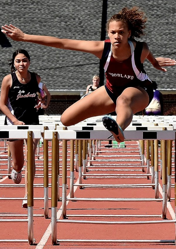 Woodland junior Mya Moffitt competes in the 100-meter hurdles during the Region 7-AAAAA championship meet Thursday at Calhoun. Moffitt won the event with a time of 17.10 seconds.