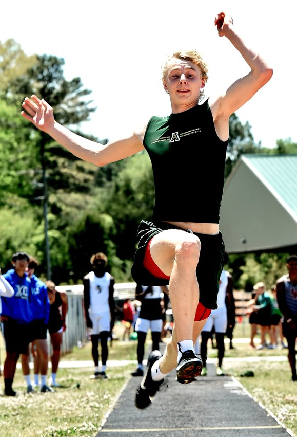 Adairsville senior Dylan Matthews competes in the long jump during the Region 6-AAA meet Monday at Rockmart. Matthews placed second in the event, as well as in the triple jump, to qualify for sectionals.