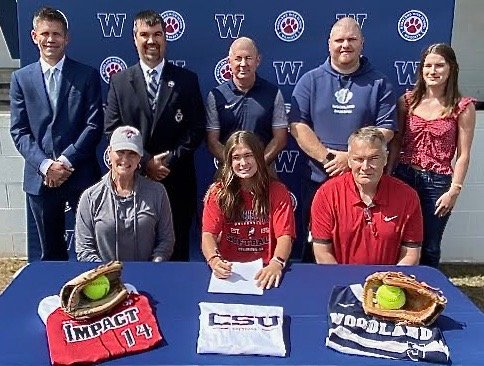 Woodland High senior Morgan Cooper signed to play softball at Columbus State. On hand for the signing were, from left, front row: Wendy Cooper, mother; Patrick Cooper, father; back row, David Stephenson, WHS principal; John Howard, WHS athletic director; Colman Roberts, former WHS head coach; Jonathan Cannon, WHS assistant coach; and Brooke Cooper, sister.
