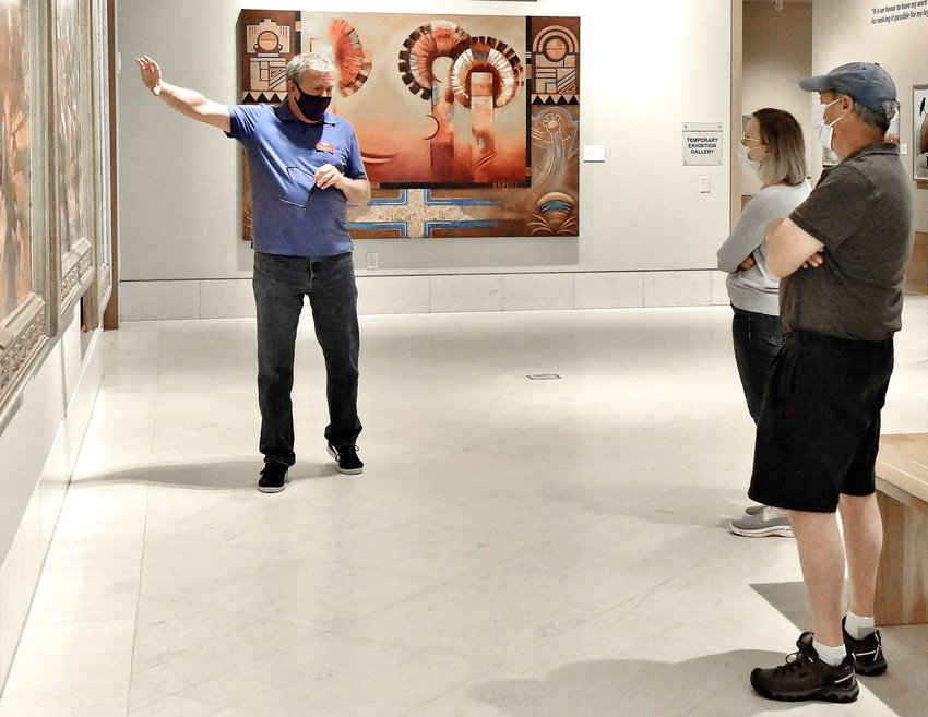 Docent James Mackey leads a tour at the Booth Western Art Museum, which was voted Best Art Museum in the USA Today 10Best Readers' Choice Awards contest.