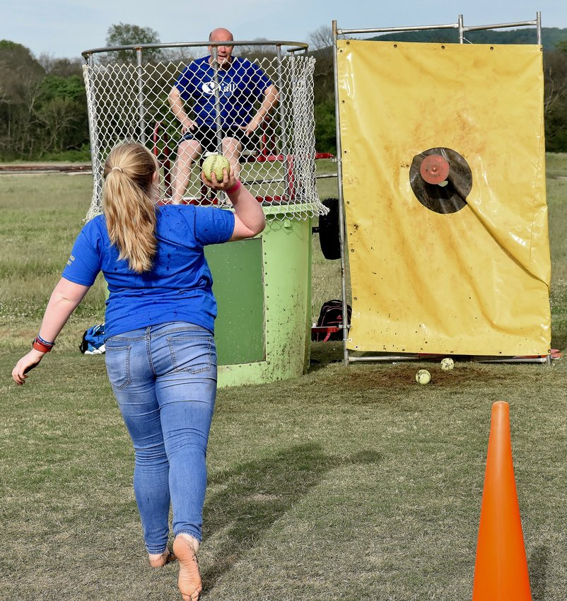 At the Cass High senior carnival April 30, CHS ninth-grader Rachel Patterson takes aim at the target of the dunking booth as CHS teacher David Rollins awaits.
