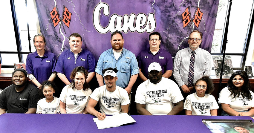 Cartersville High senior Rashar Locklear signed to wrestle at Central Methodist University in Fayette, Missouri. On hand for the signing were, from left, front row: Chris Harris, brother; Mina Locklear, sister; Sarah Locklear, mother; Terrance Moore, stepfather; Amia Jenkins, sister; Kayla Jenkins, sister; back row, Shelley Tierce, CHS principal; Tyler Putnam, CHS assistant coach; Brooks Gayton, CHS head coach; Rick Poe, CHS assistant coach; and Darrell Demastus, CHS athletic director.