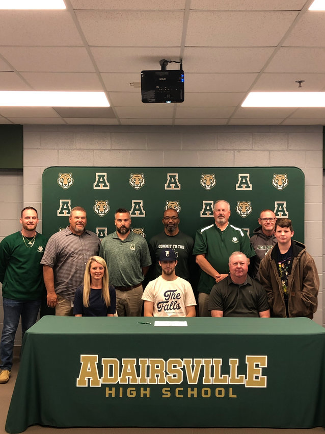 Adairsville High senior Elijah Padgett signed to swim at Toccoa Falls College. On hand for the signing were, from left, front row: Chanda Padgett, mother; David Padgett, father; Zeke Padgett, brother; back row, Josh Mitchell, AHS assistant coach; Jimmy Whittemore, AHS assistant coach; Chris Hardin, AHS assistant coach; Billy Roper AHS head coach; Bill Bishop, AHS assistant coach; and Joseph Haynes, AHS assistant coach.