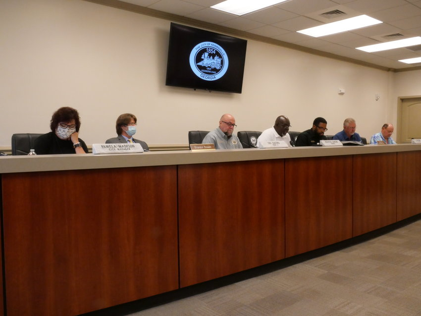 Members of the Adairsville City Council gather for Thursday evening's public meeting.